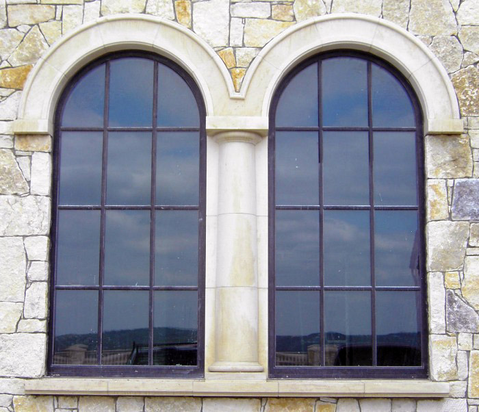 Fixed Bronze Clad Double Arched Windows